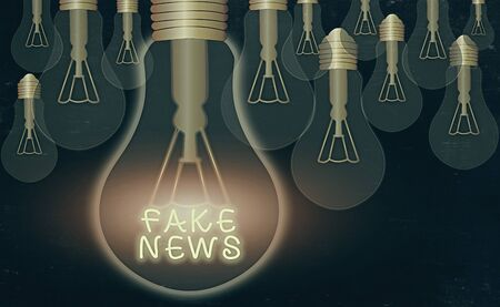 Word writing text Fake News. Business photo showcasing false information publish under the guise of being authentic news Realistic colored vintage light bulbs, idea sign solution thinking concept Stock Photo