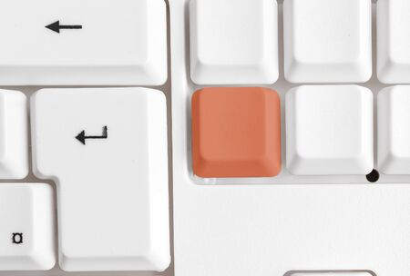 Different Colored Keyboard key With Accessories Arranged On Empty copy space Imagens