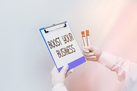 Conceptual hand writing showing Boost Your Business. Concept meaning Suitable for web Landing page, web page design to increase profit Laboratory blood test sample for medical diagnostic analysis