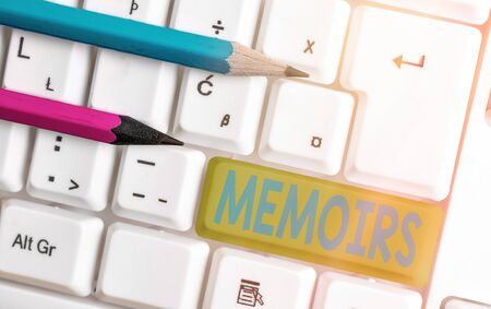 Conceptual hand writing showing Memoirs. Concept meaning collection of memories that individual writes about moments or event White pc keyboard with empty note paper above white key copy space
