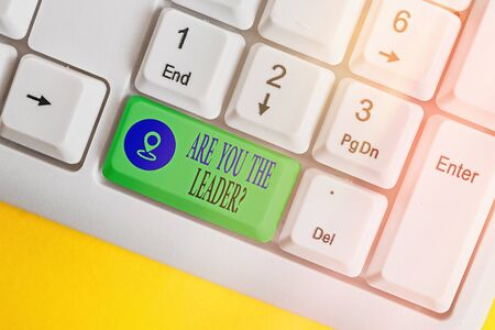 Text sign showing Are You The Leader Question. Business photo text asking for the qualification of being a good boss White pc keyboard with empty note paper above white key copy space Standard-Bild