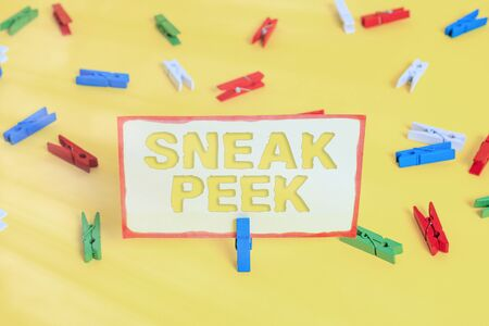 Conceptual hand writing showing Sneak Peek. Concept meaning to see before officially presented or released to the public Colored clothespin papers empty reminder yellow floor office 版權商用圖片 - 150242616