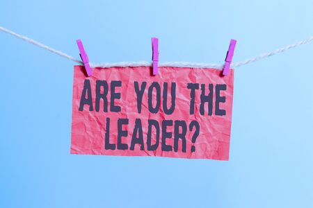 Handwriting text writing Are You The Leader Question. Conceptual photo asking for the qualification of being a good boss Clothesline clothespin rectangle shaped paper reminder white wood desk