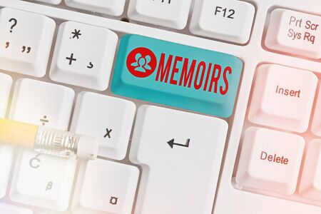 Handwriting text writing Memoirs. Conceptual photo collection of memories that individual writes about moments or event White pc keyboard with empty note paper above white key copy space
