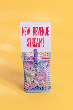 Conceptual hand writing showing New Revenue Stream Question. Concept meaning Additional Enhanced Source of Income Improved Approach Trash bin crumpled paper clothespin office supplies yellow
