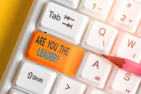 Text sign showing Are You The Leader Question. Business photo showcasing asking for the qualification of being a good boss White pc keyboard with empty note paper above white key copy space