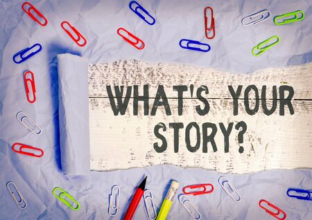 Handwriting text writing What S Your Story Question. Conceptual photo Share or tell us your life experiences and success Rolled ripped torn cardboard placed above a wooden classic table backdrop