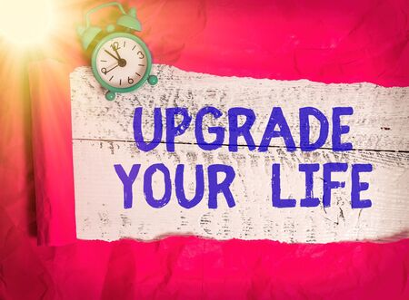 Word writing text Upgrade Your Life. Business photo showcasing improve your way of living Getting wealthier and happier Rolled ripped torn cardboard placed above a wooden classic table backdrop