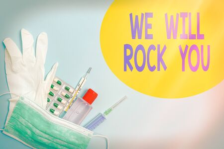 Writing note showing We Will Rock You. Business concept for to be going out and facing the world and all that is in it Primary medical precautionary equipments for health care protection