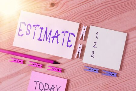 Word writing text Estimate. Business photo showcasing calculate or assess approximately the value number quantity Colored clothespin papers empty reminder wooden floor background office