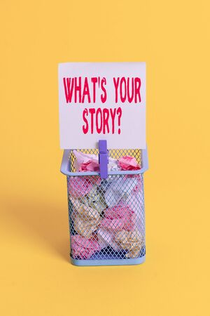 Conceptual hand writing showing What S Your Story Question. Concept meaning Share or tell us your life experiences and success Trash bin crumpled paper clothespin office supplies yellow Stock Photo