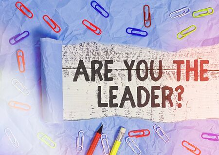 Handwriting text writing Are You The Leader Question. Conceptual photo asking for the qualification of being a good boss Rolled ripped torn cardboard placed above a wooden classic table backdrop
