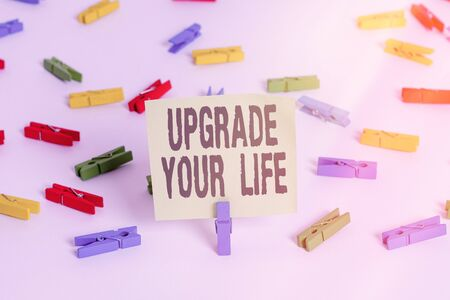 Word writing text Upgrade Your Life. Business photo showcasing improve your way of living Getting wealthier and happier Colored clothespin papers empty reminder white floor background office