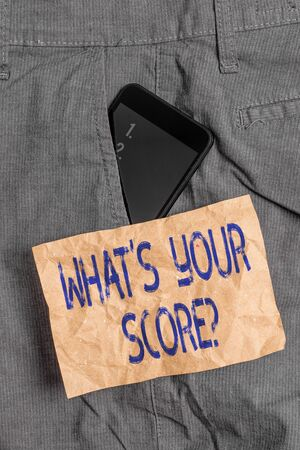 Writing note showing What S Your Score Question. Business concept for Tell Personal Individual Rating Average Results Statistics Smartphone device inside trousers front pocket note paper