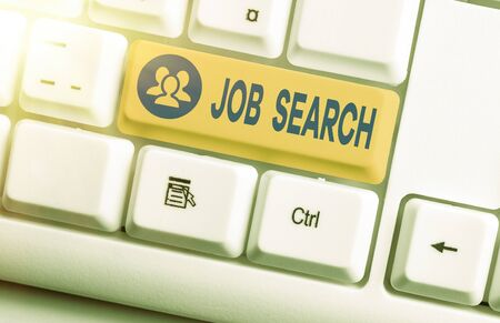 Conceptual hand writing showing Job Search. Concept meaning an act of sourcing for job openings and apply for a position White pc keyboard with empty note paper above white key copy space Standard-Bild
