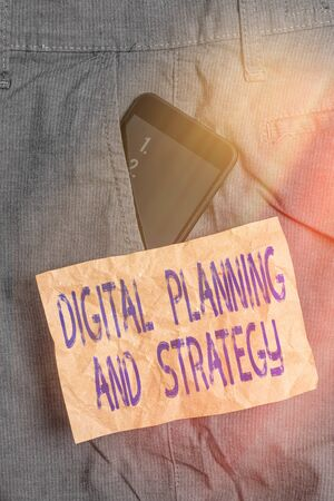 Writing note showing Digital Planning And Strategy. Business concept for business analysis in online marketing channels Smartphone device inside trousers front pocket note paper Zdjęcie Seryjne