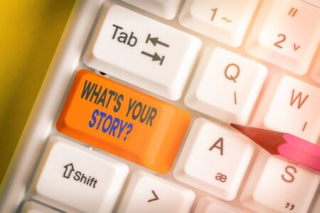 Text sign showing What S Your Story Question. Business photo showcasing Share or tell us your life experiences and success White pc keyboard with empty note paper above white key copy space