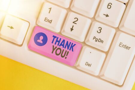 Conceptual hand writing showing Thank You. Concept meaning polite expression to acknowledge a gift, service or compliment White pc keyboard with empty note paper above white key copy space 版權商用圖片