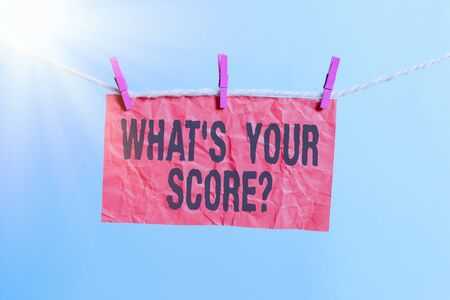 Handwriting text writing What S Your Score Question. Conceptual photo Tell Personal Individual Rating Average Results Statistics Clothesline clothespin rectangle shaped paper reminder white wood desk
