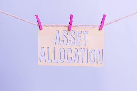 Word writing text Asset Allocation. Business photo showcasing proportion and implementation strategy to gain advantage Clothesline clothespin rectangle shaped paper reminder white wood desk