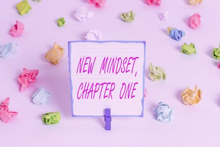 Conceptual hand writing showing New Mindset, Chapter One. Concept meaning change on attitudes and thinking Improve hard work Colored crumpled paper empty reminder white floor clothespin