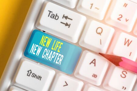 Text sign showing New Life New Chapter. Business photo text modification of brand or business Change opportunities White pc keyboard with empty note paper above white key copy space
