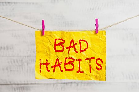 Word writing text Bad Habits. Business photo showcasing the uncontrollable negative habitual behavioral pattern of an individual Clothesline clothespin rectangle shaped paper reminder white wood desk Banque d'images
