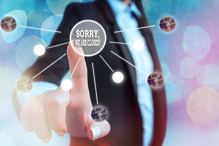 Conceptual hand writing showing Sorry, We Are Closed. Concept meaning apologize for shutting off business for specific time Solar system image.
