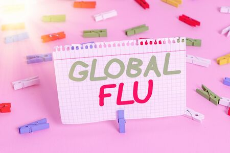 Handwriting text Global Flu. Conceptual photo Common communicable illness spreading over the worldwide fastly Colored clothespin papers empty reminder pink floor background office pin
