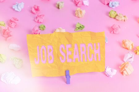 Handwriting text writing Job Search. Conceptual photo an act of sourcing for job openings and apply for a position Colored crumpled papers empty reminder pink floor background clothespin Standard-Bild