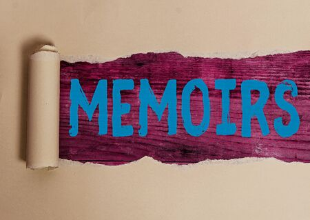 Handwriting text writing Memoirs. Conceptual photo collection of memories that individual writes about moments or event Rolled ripped torn cardboard placed above a wooden classic table backdrop