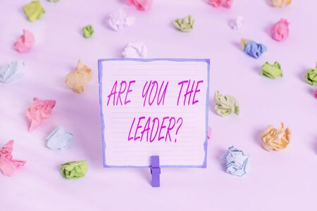 Conceptual hand writing showing Are You The Leader Question. Concept meaning asking for the qualification of being a good boss Colored crumpled paper empty reminder white floor clothespin Standard-Bild