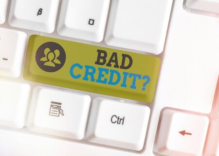 Text sign showing Bad Credit Question. Business photo showcasing a bad credit score due to nonpayment of loans White pc keyboard with empty note paper above white key copy space