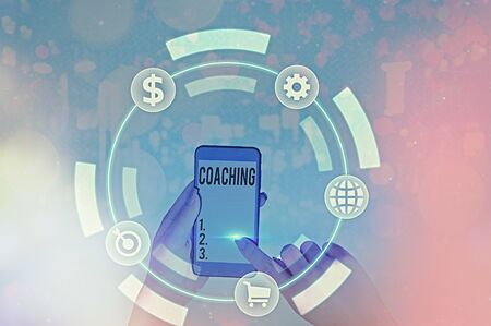 Writing note showing Coaching. Business concept for unlocking an individuals potential to maximize their own performance