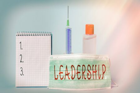 Conceptual hand writing showing Leadership. Concept meaning art of motivating to act toward achieving a common goal Set of medical equipment with notepad for health assessment Stock Photo