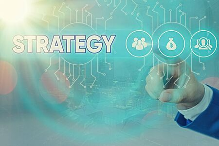 Writing note showing Strategy. Business concept for action plan or strategy designed to achieve an overall goal System administrator control, gear configuration settings tools concept
