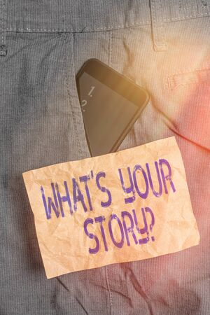 Writing note showing What S Your Story Question. Business concept for Share or tell us your life experiences and success Smartphone device inside trousers front pocket note paper Stock Photo