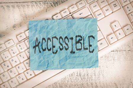 Text sign showing Accessible. Business photo text defined as something you can get to use or obtain or reach White keyboard office supplies empty rectangle shaped paper reminder wood