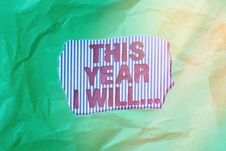 Conceptual hand writing showing This Year I Will.... Concept meaning things plan to do for a period of time Personal guide Green crumpled colored paper sheet torn colorful background
