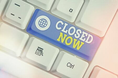 Text sign showing Closed Now. Business photo showcasing of a business having ceased trading especially for a short period White pc keyboard with empty note paper above white key copy space