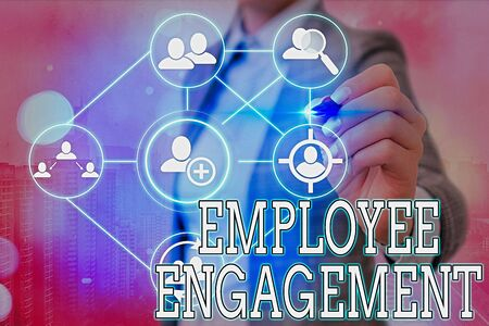 Writing note showing Employee Engagement. Business concept for extent to which workers feel passionate about their jobs
