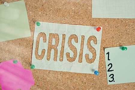 Text sign showing Crisis. Business photo text event that is going to lead to an unstable and dangerous situation Corkboard color size paper pin thumbtack tack sheet billboard notice board Banque d'images