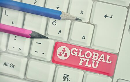 Text sign showing Global Flu. Business photo showcasing Common communicable illness spreading over the worldwide fastly White pc keyboard with empty note paper above white key copy space
