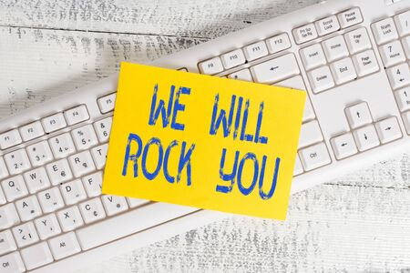 Handwriting text We Will Rock You. Conceptual photo to be going out and facing the world and all that is in it White keyboard office supplies empty rectangle shaped paper reminder wood Archivio Fotografico
