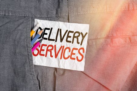 Text sign showing Delivery Services. Business photo showcasing process of transporting goods from a source to destination Writing equipment and white note paper inside pocket of man work trousers