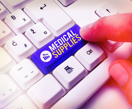 Word writing text Medical Supplies. Business photo showcasing Items necessary for treatment of illness or injury White pc keyboard with empty note paper above white key copy space