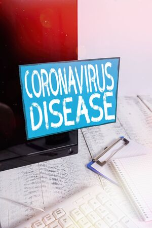 Writing note showing Coronavirus Disease. Business concept for defined as illness caused by a novel virus SARSCoV2 Note paper taped to black computer screen near keyboard and stationary