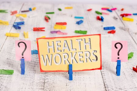 Word writing text Health Workers. Business photo showcasing showing whose job to protect the health of their communities Scribbled and crumbling sheet with paper clips placed on the wooden table 免版税图像 - 150266076