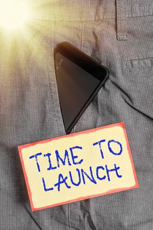 Handwriting text writing Time To Launch. Conceptual photo Business StartUp, planning and strategy, management, realization Smartphone device inside formal work trousers front pocket near note paper