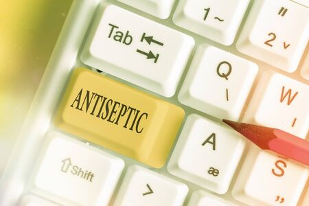 Conceptual hand writing showing Antiseptic. Concept meaning antimicrobial agents that delays or completely eliminate the microorganism White pc keyboard with empty note paper above white key copy space
